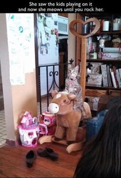 Apparently this cat saw her little peeps rocking on this horse. Now she will sit…