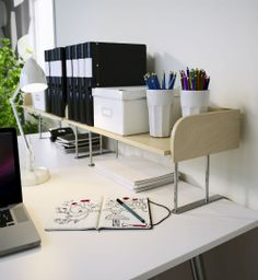 Need more room to spread out? Let IKEA and a raised desktop shelf, like GALANT, give you a hand.