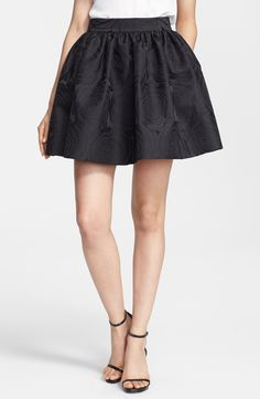 Wardrobe essential! Cute black Kate Spade jacquard cupcake skirt.