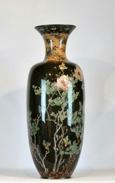 "Large Japanese cloisonne vase with brightly colored enameled designs of floral and butterflies on a gloss black background. 36.5""H X 13""W; 10.5"" top."