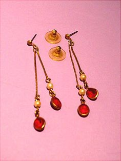 Vintage pierced earrings.  I like them for parts.  Great pieces for making jewelry for dolls.  Sold on my website http://barbspencerdolls.com