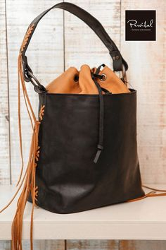 Hand-made bucket bag in matte black premium leather and soft caramel leather…