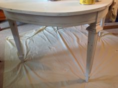 Beautiful vintage dining room table with gold accents, chalk painted with a hand rubbed wax finish.