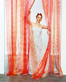 Ribbons: A grand Entrance    A curtain of sheer, iridescent organdy ribbons assembled on a tension rod lends drama wherever it hangs. Use it at the altar, as a backdrop for photos, or in the doorway at the reception.