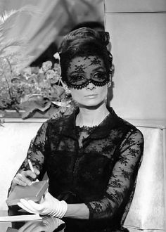 "Audrey in Givenchy's dramatic black lace dress, matching jacket and mask in the film ""How to Steal a Million"", with Peter O'Toole, directed by William Wyler, 1966 