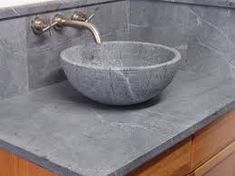 Soapstone with either mineral oil or wax applied to surface.       (photo credit: houzz.com) Soapstone with natural finish.       (photo credit: www.soapstones.com)     Soapstone is a natural material, a metamorphic rock that is composed primarily of talc with varying amounts of chlorite, micas, amphiboles, carbonates and other minerals. Soapstone was …