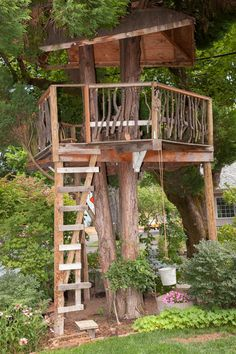 Swiss Family Robinson tree house. Inspire imaginative play with a rustic tree house made for outdoor adventures. This one was created using scrap wood and includes a bucket on a pulley — perfect for passing secret messages and other things up to those in the tree house.