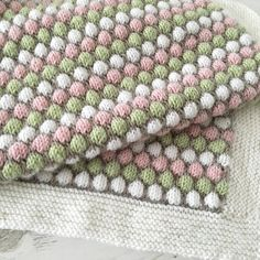 This beautiful baby blanket is knit in 3 colour repeat rows of bubble stitch with a fourth colour outlining the bubbles. You can, of course use fewer colours if you wish.The pattern includes a detailedphoto tutorial on how to knitthe bubble stitch.The blanket is knit in double knit weight yarn and 2 sizes of blanket are included in the pattern. The smaller size is ideal as a receiving blanket, for swaddling, for tummy time or for the stroller. The larger size will fit a cot or could be…