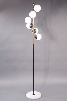 "Floor Lamp Stilnovo Italy, 1950s Six light floor lamp composed of a gray marble base supporting a brass shaft issuing white glass spherical shades. Height: 68-1/2"" Base Diameter: 12"" Code : N-7837"