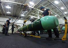 Sailors secure a Mark 48 torpedo aboard the submarine tender USS 'Emory S. Land.' U.S. Navy photo