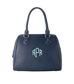 """Signature A-Line - Navy 14.25""""W x 12""""H x 5""""D Classic shape. Features Initials, Inc. metal logo plates, embossed zipper pulls, metal feet, faux leather details and metal studs. Double handles with 7.5"""" drop. Zippered back pocket. Top zip closure extends down the sides to allow for ample access to bag contents. Interior zipper pocket. Includes a logo dust bag for safe storage."""