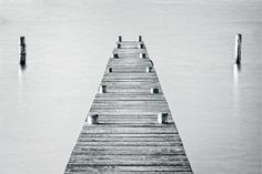 A timber jetty on a lake #jetty #pier #minimal #blackandwhite #blackandwhitephotography