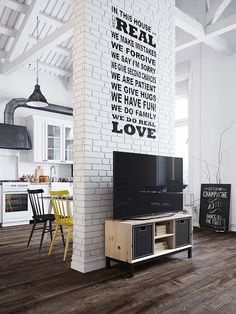 Fascinating Scandinavian style loft apartment in Prague | Great saying on Brick Wall!