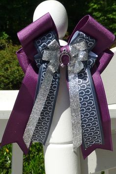 Check out this up and coming designer of horse show hair bows! The bows are so cute! She is willing to do custom designs as well!  http://creekviewfarm.com/Creekview_Farm/Horse_Show_Hair_Bows.html