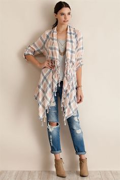 The Kara top is a very lightweight plaid open cardigan. Details include fringed hemming and roll up sleeves. This top is unlined. Pair it with distressed denim, our booties and one of our floppy hats!