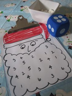 Fine motor activity and a christmas activity. Except since some of the kids are older, I'd add a rule that if they roll a number that is not available, they have to eat one of their marshmallows and hope they have enough to cover their board! First one to fill their board, wins a small christmas trinket (play several times, past winners cannot win again, till all players get a trinket)