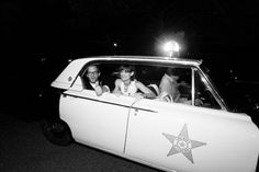 The best getaway car for a bride and groom...a vintage police car. So fun!
