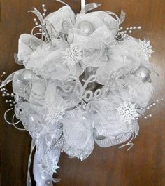 As a concept for wedding decorations: Christmas Winter Wonderland - Deco Mesh Wreath - Silver and White - Snow Flakes and Silver Ornaments can all be customized for a wedding.Deco Mesh Wreath - Silver and White - Snow Flakes and Silver Ornaments. Christmas Mesh Wreaths, Christmas Crafts, Christmas Decorations, Winter Wreaths, Spring Wreaths, Summer Wreath, Wedding Decorations, Wreath Crafts, Diy Wreath