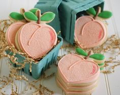 so cute just use a heart shaped cookie cutter keep some of the extra dough for the stem then just ice to look like the peaches