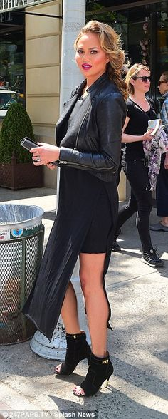 Fierce but fun:Earlier she stepped out in a motorcycle jacket over a black dress and open...