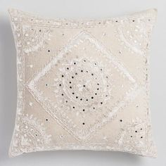 Ornamented with tiny pakka mirrors and lavish embroidery, this white throw pillow with natural back imbues your space with radiant style.