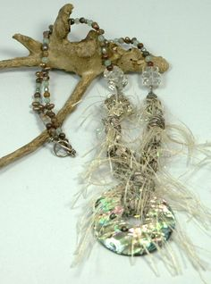 Imported Italian fiber wrapped around a beautiful Abalone shell is another piece in our JeanneMarie Originals fiber line.  It is beaded up with Sterling Silver, fresh water pearls, aventurine and vintage crystals.  SOLD