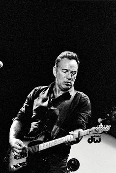 Springsteen on guitar.