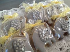 Pretty packaged elephant cookies at a gray and yellow elephant baby shower! See more party ideas at CatchMyParty.com! #partyideas #babyshower