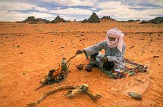 Algeria  Djanet Man of Tuareg tribe Making tea Sahara Desert