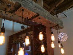 Reclaimed barn beam light fixture with Edison bulbs. Description from etsy.com…