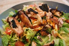 Applebee's Blackened Chicken Salad Copycat Recipe    Cajun grilled chicken on top of a bed of greens, with tomatoes and hard boiled eggs in ...