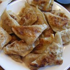 These Japanese pot stickers are a fun favorite! Little fried wrappers are filled with pork and veggies, and dipped into a tasty sauce. Yummy Appetizers, Appetizers For Party, Appetizer Recipes, Snack Recipes, Cooking Recipes, Snacks, Asian Recipes, Mexican Food Recipes, Great Recipes