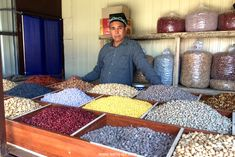 This man sells delicious nuts and dried fruits at the bazaar in Snacks, Fruit, Vegetables, Breakfast, People, Food, Tapas Food, Appetizers, Hoods