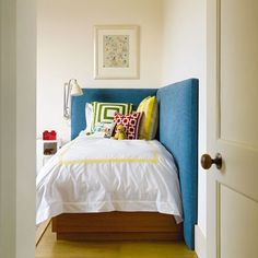 Designer Hugh Leslie has not only created a simply chic scheme of primary colours and graphic prints, but a cosy wrap around headboard ensures there'll be no danger of little ones going bump in the night.  May 2012 H&G UK