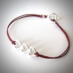 For Mom! Sterling Love Love Love bracelet on linen from JewelryByMaeBee on Etsy.