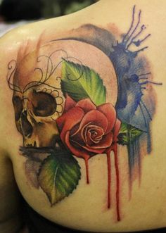 loving the watercolor/paint dripping technique on her tattoos, skull and rose tattoo. Artist: Lianne Moule