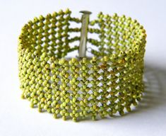 Kiwi green beaded cuff - a mixture of chartreuse green seed beads with little black flecks in a Picasso finish. These beaded cuffs have a