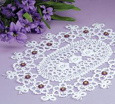 Butterfly Dreams doily crochet pattern. This adventurous design by Ferosa Harold combines the techniques of crochet with the look of tatting to form a gorgeous oval doily anyone will appreciate. It would also be a great way to showcase your favorite antique shank buttons! Free Pattern More Patterns Like This!