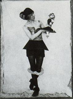 Hannah Höch with one of her Dada dolls, c. 1925, courtesy Berlinische Galerie.