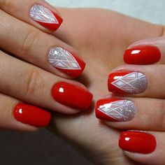 Red nails with white artsy accent nails