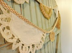 Brilliant idea! Doilies cut in half and sewn along binding to create garland, flags, banner, whatever your preferred term. I'm going to check out the flea market for doilies tomorrow! This will fit my tea party birthday theme perfectly!