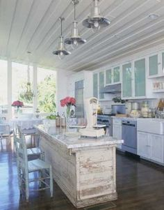 KITCHEN. Love the color scheme. Lots of white. Touches of light blue. Accent with pink. Love the island. Chandeliers vs. the ones shown. Maybe a sandy brown wood floor or white wood floor. - Kim