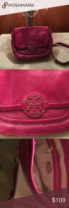Tory Burch leather purse Never used!  Mint condition...gold accents.  Bought it to use as a cross body, but the length is that of a shoulder bag. Tory Burch Bags Shoulder Bags