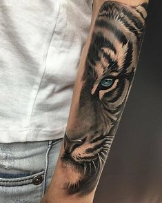 Today, tattoos have become a cool way to show off your personality or sentimentality. Arm tattoos can be detailed and look seriously cool if you do them right. Below, we are going to mention tiger tattoo designs and ideas. Mens Tiger Tattoo, Tiger Eyes Tattoo, Tiger Tattoo Sleeve, Sleeve Tattoos, Modern Tattoo Designs, Hair Tattoo Designs, Tattoo Ideas, Trendy Tattoos, Popular Tattoos