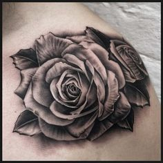 Or these photo-realistic roses. | 49 Bloody Brilliant Black And Grey Tattoo Ideas