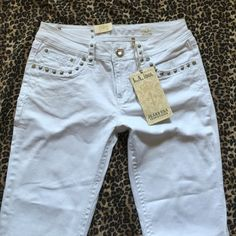 White LA IDOL jeans Embellished W/ shiny bling Beautiful summer jeans!! Women's/juniors size 13- These are a GORGEOUS pair of white pants/Jean material with stretch, low rise, flare legs & embellished with shiny Rhinestones, silver studs & hardware & neat stitching!!! Super comfy material, very stylish & new with tags!!! Only tried on, never worn!! These are awesome for the perfect summer evening event with your favorite heels & summer top!! Beautiful  Any questions, please ask!! Thank you…