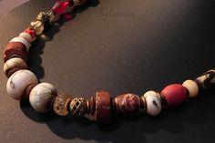 Bijou tribal en perles anciennes, creation ethnique avec Agates Dzi Tibétaines, perles en coquillage Naga, perles en bronze et agates africaines