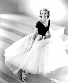 Grace Kelly in Edith Head dress with black v neck body and white tule embroidered midi skirt