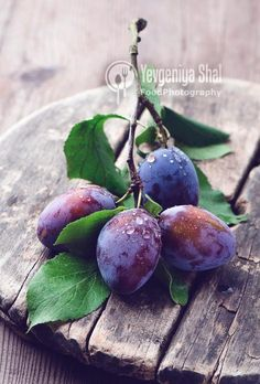 fresh plums on woode