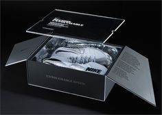 Limited Edition: Nike's limited-edition packaging for its Vapor Untouchable football shoes included an invitation to an exclusive event, and were sent to the top 16 high-school football teams in Texas. Secured with a black band, the satin silver metallic box opens via two angular magnetically secured flaps to reveal the screen-printed acrylic invitation, which acts as a protective panel and an alluring window to the silver trainers beneath.  http://www.stylus.com/rgrbsl